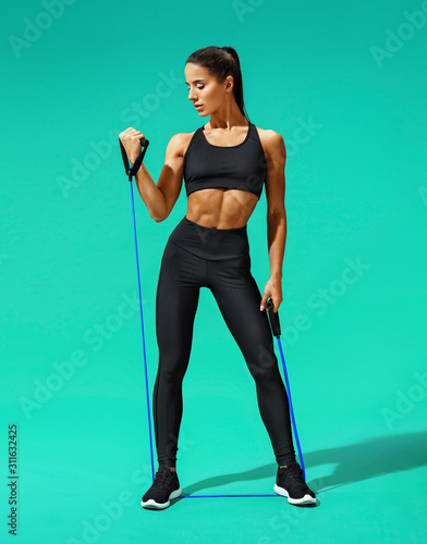 Strong woman working with resistance band Wallpaper Mural