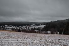 View Of The Slightly Snowy Village Of Kvilda, Near Vimperk. Sumava