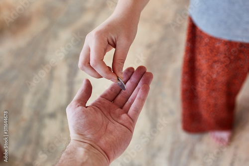 Photo  a person a donates money to beggar