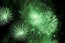 Luxury Fireworks Event Sky Show With Green Big Bang Stars. Premium Entertainment Magic Star Firework At E.g. New Years Eve Or Independence Day Party Celebration. Black Dark Night Background