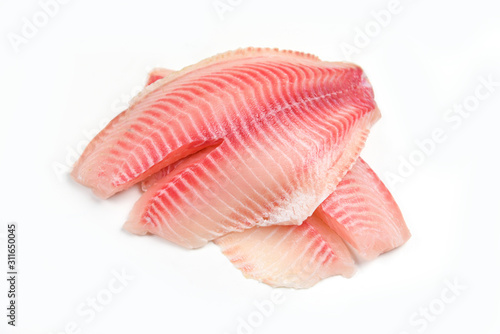 Slika na platnu Raw tilapia fillet fish isolated on white background for cooking food - Fresh fi