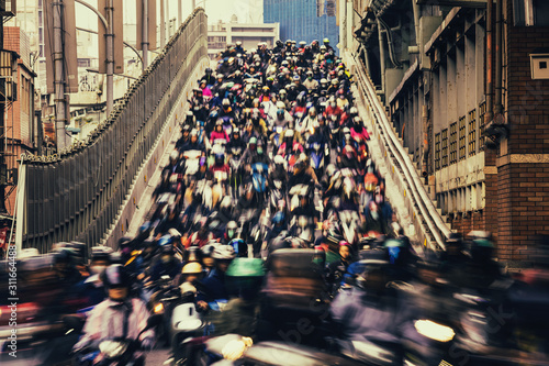 Chaos/ The crowd of people are riding scooter, shot with slow shuttle speed like waterfall in Taipei, Taiwan - 311664488