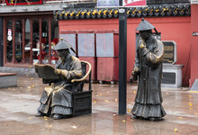 Sculpture Of Two Examiners Wit...
