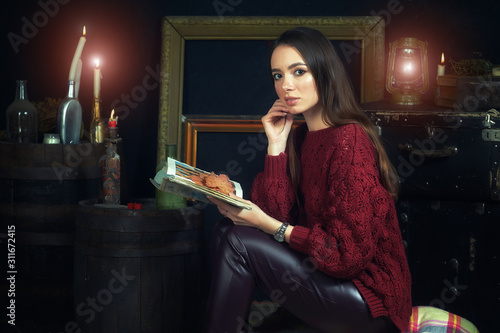 young woman with candles on dark background, divination and spiritualism Принти на полотні