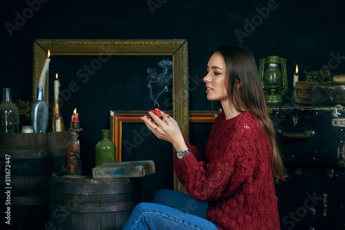 young woman with candles on dark background, divination and spiritualism Фотошпалери