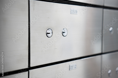 Fototapeta Metal safe box panel wall. Concept for security and banking protection. obraz