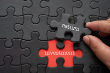 Hand Hold Piece Of Puzzle Written RETURN Revealing Word INVESTMENT. Business Concept.