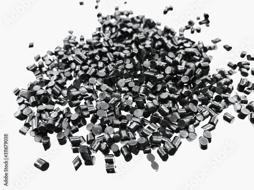 Fotografía  Close-up of black plastic polymer granules on white background