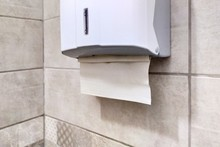 Paper Towel Holder In The Bathroom. Dispenser With Paper Towels. Drawer With Paper Napkins For Hands. Personal Hygiene.