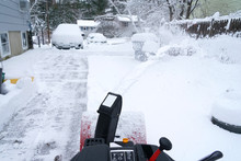 Snow Blower Cleaning Snow On T...