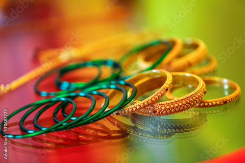 Photo glass and gold bangle for traditional event