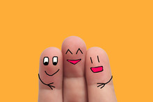 Three Best Friends Hands Fingers Of Man And Woman On Yellow Background