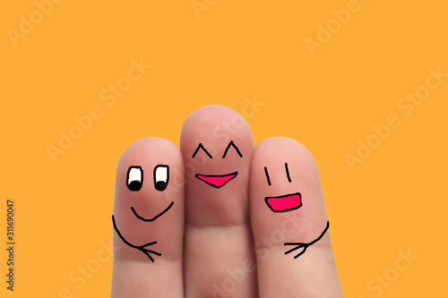 three best friends hands fingers of man and woman on yellow background Tablou Canvas