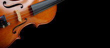 Fragment Of A Violin On A Blac...