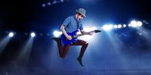 Guitarist At Concert. Mixed Me...