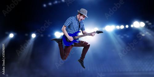 Guitarist at concert. Mixed media - 311698891