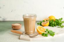 Jar Of Tasty Tahini On Light Background