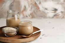 Jars Of Tasty Tahini On Table