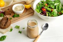 Jar Of Tasty Tahini On Table