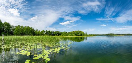 Fototapeta Panorama of beautiful summer day on masuria lake district in Poland