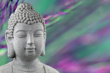 Buddha Statue Head Isolated On Blurred Green And Purple Background With Copy Space