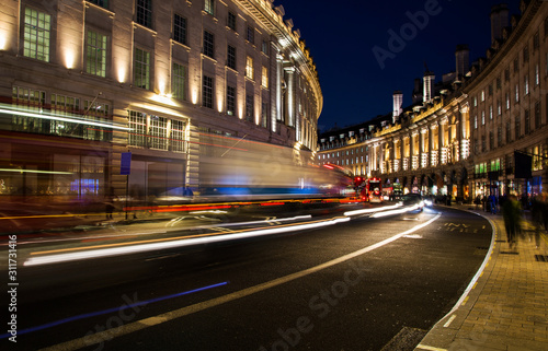 night scene of London city United Kingdom with the moving red buses and cars - l Wallpaper Mural