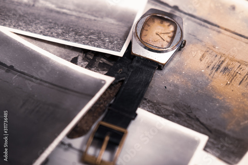 Photo Old watch and photos, family ancestry, memories concept