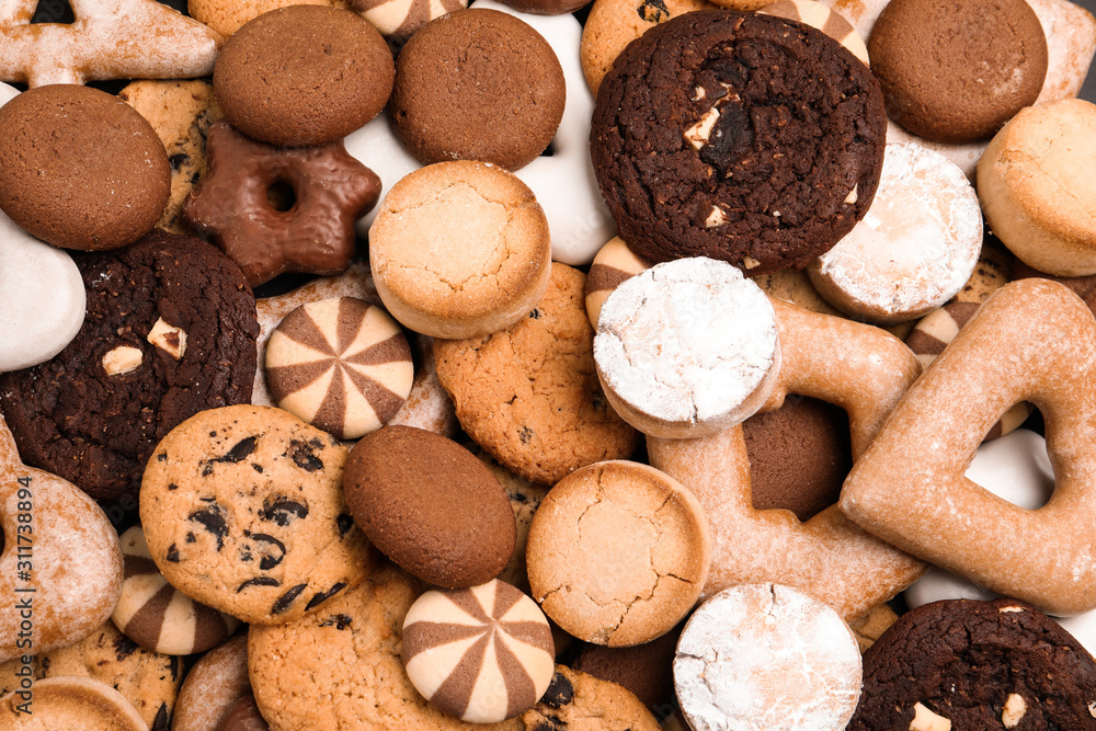 Fototapeta Different delicious cookies as background, top view