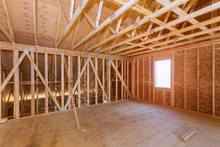 Unfinished Attic Of Private House Residential Construction House Framing Agains