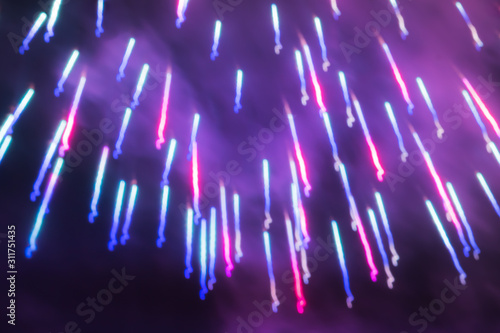 Photo Abstract Sparkling Magenta Red, Phantom Blue and Ultra Violet Golden Rain Firewo
