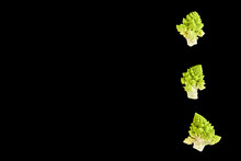 Romanesco Broccoli Or Roman Cauliflower, A Type Of Cauliflower. Isolated On A Black Background.