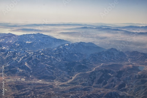 Wasatch Front Rocky Mountain Range Aerial view from airplane in fall including urban cities and the Great Salt Lake around Salt Lake City, Utah, United States of America. USA.