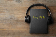 Bible And Headphones On Wooden...