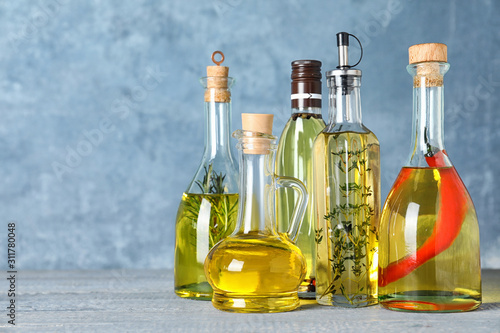 Fototapeta Different cooking oils on wooden table. Space for text obraz