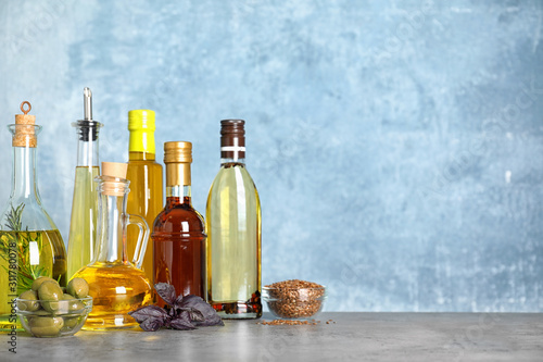 Fototapeta Different cooking oils on grey table. Space for text obraz