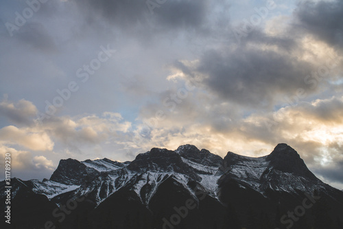 Snowy Canadian mountain range on a cloudy beautiful day