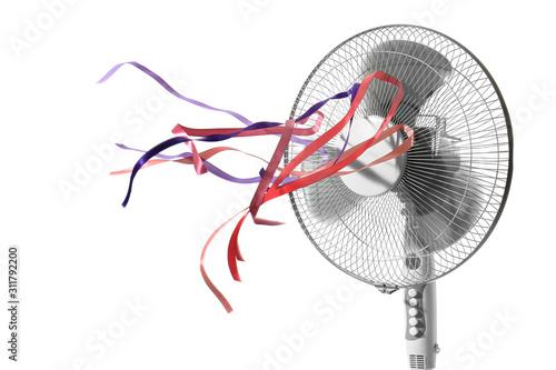 Fototapeta Electric fan with fluttering ribbons on white background obraz