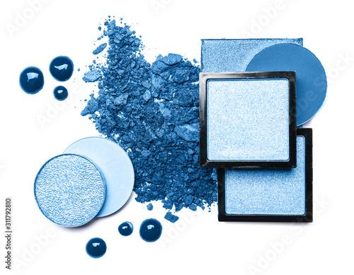 Set of blue eyeshadows on white background