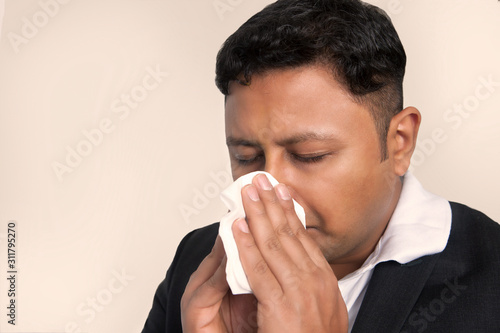 Man blowing nose holding tissue paper Canvas Print