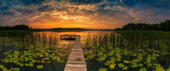 Panorama of beautiful sunrise over lake