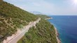 Aerial shot of a car following the beautiful coastline of Montenegro