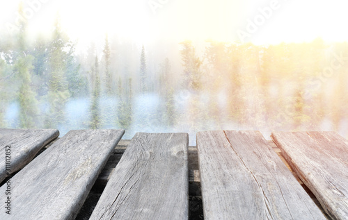empty wooden tabletop on the winter forest background Fototapete