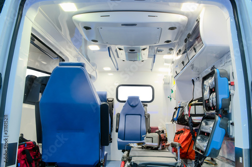 Inside an ambulance car with medical equipment for helping patients before delivery to the hospital Canvas Print