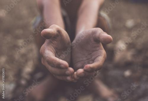 poor child or beggar begging you for help sitting at dirty slum Tapéta, Fotótapéta