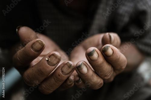 Fényképezés  poor old man or beggar begging you for help sitting at dirty slum