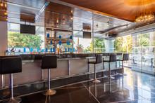 Lounge Bar Of Modern European Resort Hotel, Interior With Terrace, Tables, Lighting. Rhodes, Greece