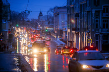 Vladivostok, Russia - Cars Drive Along Central Snowy Roads. Snowfall In The City.