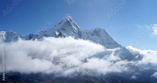 Ama Dablam 6814m clouds covered peak View near Dingboche settlement in Sagarmatha National Park, Nepal Canvas Print