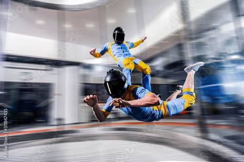 Fototapety, obrazy: Speed. Fly men is a pilot of his body in air. Extreme people prefer skydiving. Parachutist in blue suit. Free lifestyle.
