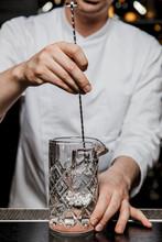 Bartender Prepairing A Cocktai...
